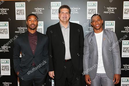 From left, Actor Michael B Jordan, ESPN personality Mike Golic and NY Giant Victor Cruz arrive at 'We Could Be King' Premiere at the Sunshine Cinema on in New York, NY