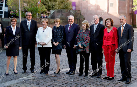 (L-R) Andreas Vosskuhle, President of the Federal Constitutional Court and his wife Eva, German Chancellor Angela Merkel, The German President's wife Elke Buedenbender, German President Frank-Walter Steinmeier, German 'Bundestag' parliament  President Norbert Lammert and his wife Gertrud, and German Federal Council (Bundesrat) President Malu Dreyer and her husband Klaus Jensen attend the celebrations of the Day of German Unity in Mainz, Germany, 03 October 2017. The German Day of Unity, celebrating the reunification of East and West Germany in 1990, with its official national ceremony and celebrations is taking place in Mainz on 03 October 2017.