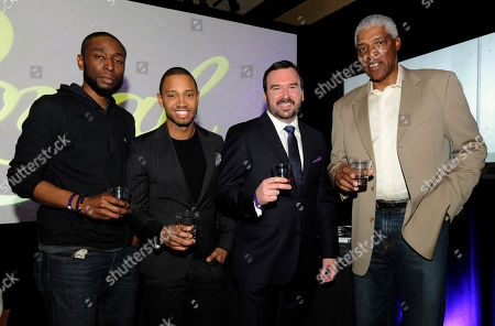 Hip Hop producer 9th Wonder, left, Terrence J, Master of Whisky Stephen Wilson, and basketball legend Dr. J pose for a photo at the Crown Royal Reign On launch party during All-Star weekend, in Houston. Reign On is Crown Royal's new advertising campaign released this week