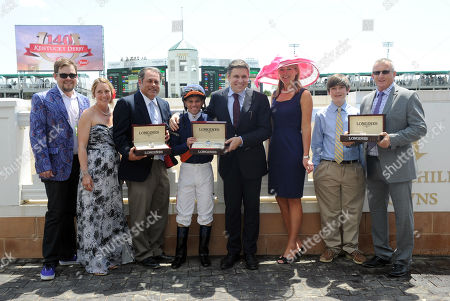 Jennifer Judkins, third right, and Juan-Carlos Capelli, center right, both of Longines, award representatives from Amerman Racing Stables, left, jockey Javier Castellano, center, and trainer Brian Lynch, right, with their Longines timepieces after Coffee Clique wins the Churchill Distaff Turf Mile presented by Longines, in Louisville, Ky. Longines, the Swiss watchmaker known for its famous timepieces, is the Official Watch and Timekeeper of the 140th annual Kentucky Derby