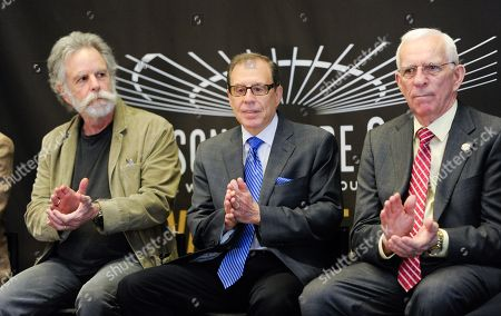 Stock Image of Bob Weir, left, of the Grateful Dead, photographer George Kalinsky and hockey great Eddie Giacomin pictured at the Madison Square Garden 2015 Walk of Fame Induction ceremony, in New York
