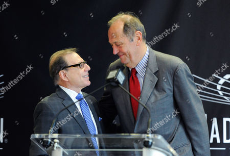 Photographer George Kalinsky, left, is inducted into the Madison Square Garden 2015 Walk of Fame by Bill Bradley, in New York
