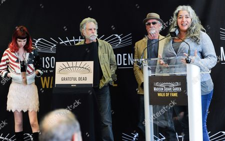 Trixie Garcia, representing her father Jerry Garcia, speaks at the Madison Square Garden 2015 Walk of Fame Induction ceremony honoring The Grateful Dead, in New York. Also pictured is Mickey Hart's daughter Reya Hart, left, Bob Weir, second left, and Bill Kreutzmann