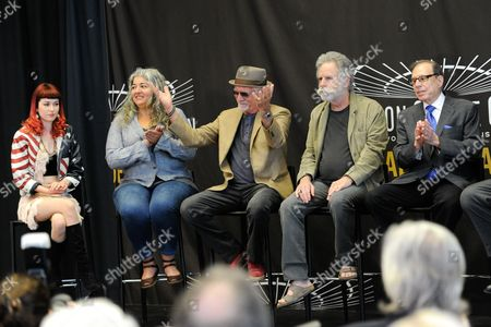 Musicians Bill Kreutzmann, left, and Bob Weir of the Grateful Dead are joined by Reya Hart, far left, and Trixie Garcia, representing their fathers Mickey Hart and Jerry Garcia, at the Madison Square Garden 2015 Walk of Fame Induction ceremony, in New York