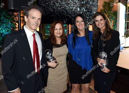 """Nick Doob, from left, Shari Cookson, Katrina Gilbert, and Maria Shriver pose with the Television Academy Honors award for """"Paycheck to Paycheck: The Life and Times of Katrina Gilbert"""" at the 8th annual Television Academy Honors at the Montage hotel, in Beverly Hills, Calif"""