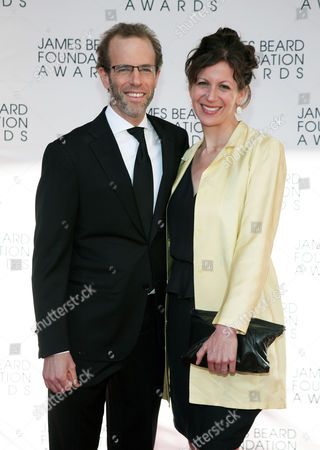 Restauranteur Dan Barber, left, and his wife Aria Beth Sloss, right, arrive at the James Beard Foundation Awards Gala, in New York