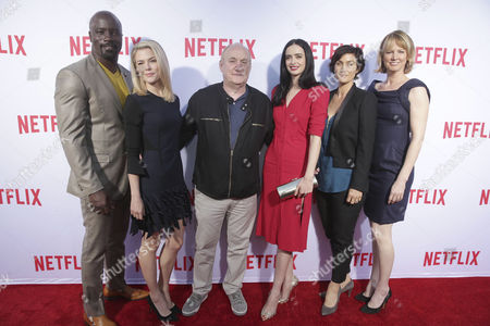 """Mike Colter, Rachael Taylor, Exec. Producer Jeph Loeb, Krysten Ritter, Carrie-Anne Moss and Creator/Exec. Producer Melissa Rosenberg seen at Netflix original series """"Marvel's Jessica Jonesâ?? TV Academy FYC event at the Paramount Theatre, in Los Angeles"""