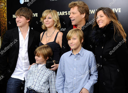 """Singer and actor Jon Bon Jovi poses with his wife Dorothea and children Stephanie, Jesse, Jacob and Romeo at the premiere of """"New Year's Eve"""" at Ziegfeld Theatre on in New York"""