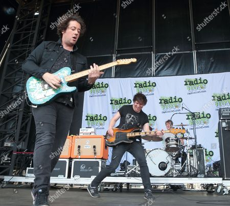 Stock Picture of Matthew Murphy, from left, Tord Øverland Knudsen and Dan Haggis of the band The Wombats perform in concert during the Radio 104.5 Summer Block Party at Festival Pier, in Philadelphia