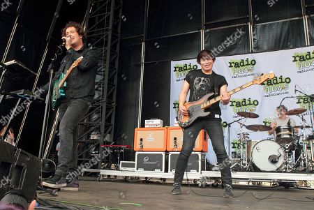 Stock Image of Matthew Murphy, from left, Tord Øverland Knudsen and Dan Haggis of the band The Wombats perform in concert during the Radio 104.5 Summer Block Party at Festival Pier, in Philadelphia