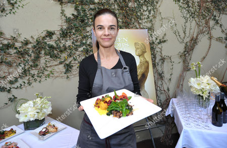 Chef Suzanne Goin poses for photographers at the Screen Actor's Guild Awards menu tasting event at Lucques restaurant, in Los Angeles