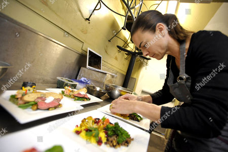 Chef Suzanne Goin prepares food at the Screen Actor's Guild Awards menu tasting event at Lucques restaurant, in Los Angeles