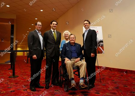 IMAGE DISTRIBUTED FOR AMC - Former President George H.W. Bush, second from the right, with former first lady Barbara Bush, third from the left, executive producers of AMC's TURN, Craig Silverstein, left, and Barry Josephson, right and author of 'Washington's Spies', Alexander Rose, second from the left, attend a private screening of the network's new series on Saturday, March, 29, 2014 in Houston, Texas