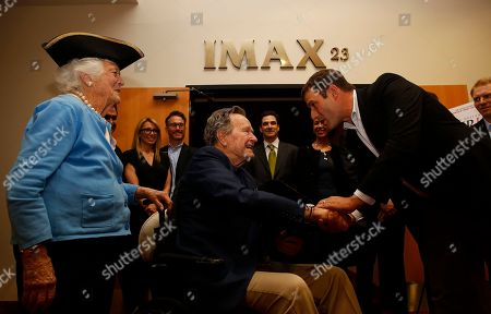 IMAGE DISTRIBUTED FOR AMC - Former President George H.W. Bush, center, greets actor Ian Kahn, right, who plays George Washington in AMC's new series TURN, as former first lady Barbara Bush, left, looks on at a private screening of AMC's new series on Saturday, March, 29, 2014 in Houston, Texas