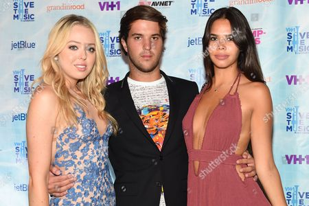 Tiffany Trump, left, Andrew Warren, center, and Reya Benitez arrive at VH1's Save The Music Foundation's Hamptons Live Benefit, in Sagaponack, NY