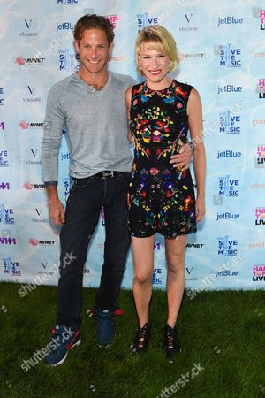 Stock Image of Julie Macklowe, right, and Billy Macklowe arrive at VH1's Save The Music Foundation's Hamptons Live Benefit, in Sagaponack, N.Y
