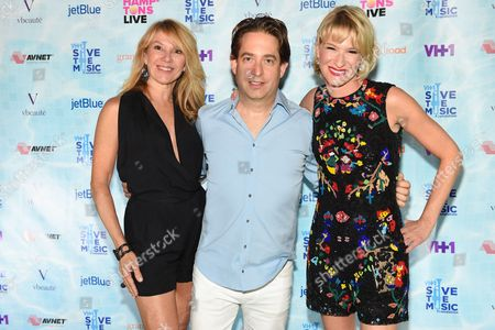 Reality TV star Ramona Singer, left, Charlie Walk, center, and Julie Macklowe arrive at VH1's Save The Music Foundation's Hamptons Live Benefit, in Sagaponack, NY
