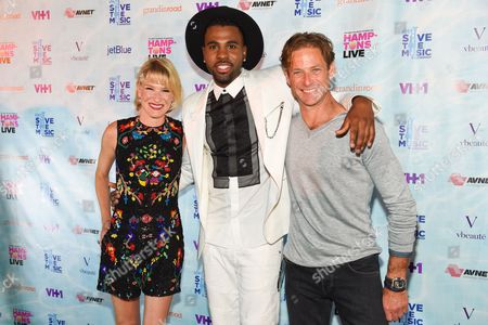 Stock Picture of Julie Macklowe, from left, Jason Derulo, middle, and Billy Macklowe arrive at VH1's Save The Music Foundation's Hamptons Live Benefit, in Sagaponack, NY