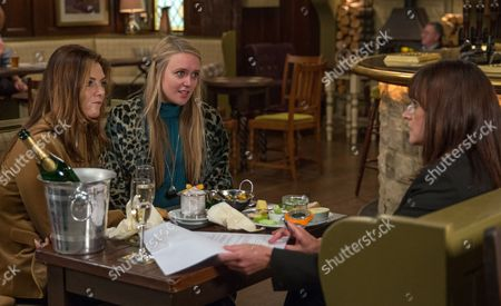 Stock Image of Ep 7965 Wednesday 18th October 2017  Chrissie White, as played by Louise Marwood, is puzzled when she fails to find any information about the company RTB online. Chrissie prepares to grill Kath, as played by Claire Cage, (Robert's investor) ahead of her RTB business meeting with Rebecca White, as played by Emily Head, . The meeting is over before is starts as Rebecca arrives and Chrissie immediately mentions Robert. Kath is offended and pulls out of the deal.