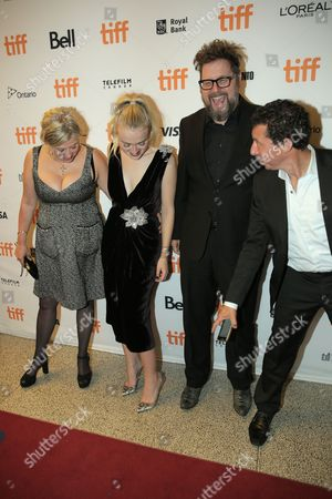 Els Vandevorst, from left, Dakota Fanning, Martin Koolhoven and Paul Trijbits attend the Brimstone premiere on day 5 of the Toronto International Film Festival at the Elgin Theatre, in Toronto