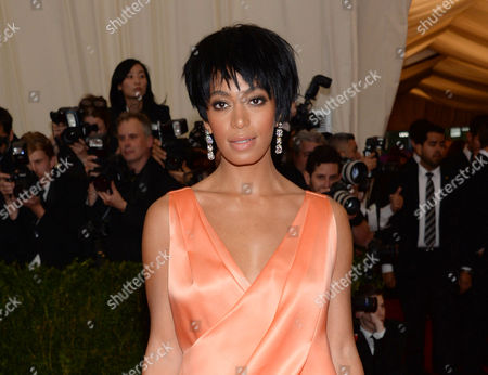 "Solange Knowles, sister of Beyonce Knowles, at The Metropolitan Museum of Art's Costume Institute benefit gala celebrating ""Charles James: Beyond Fashion"" in New York. The 28-year-old singer (and sister of Beyonce) wed video director Alan Ferguson, 51, over the weekend, her publicist confirmed on"