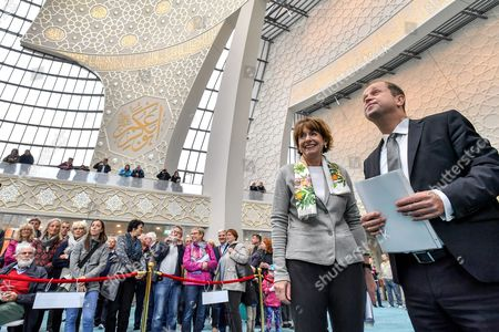 (R-L) Joachim Stamp, Minister of Integration in North Rhine-Westphalia and Mayor of Cologne Henriette Reker, attend the 'Day of the Open Mosque' at DITIP Merkez Camii mosque in Cologne, Germany, 03 October 2017. The Islamic place of prayer in the Cologne-Ehrenfeld district is Germany's central mosque providing space for more than 1,200 people and was comissioned by the Turkish-Islamic Union for Religious Affairs (DITIB). 'The Day of the Open Mosque' should strengthen the trust between Muslims and non-Muslims and reduce mutual prejudices.