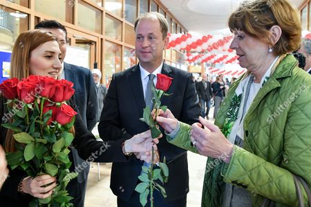 Joachim Stamp (C), Minister of Integration in North Rhine-Westphalia and Mayor of Cologne Henriette Reker (R) receive roses as they arrive for the 'Day of the Open Mosque' at DITIP Merkez Camii mosque in Cologne, Germany, 03 October 2017. The Islamic place of prayer in the Cologne-Ehrenfeld district is Germany's central mosque providing space for more than 1,200 people and was comissioned by the Turkish-Islamic Union for Religious Affairs (DITIB). 'The Day of the Open Mosque' should strengthen the trust between Muslims and non-Muslims and reduce mutual prejudices.