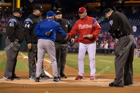 Pete Mackanin, Terry Collins. Philadelphia Phillies manager Pete Mackanin, right, shakes hands with New York Mets manager Terry Collins, left, as they meet with the umpires prior to the first inning of a baseball game, in Philadelphia. The Mets won 7-4 in 11 innings