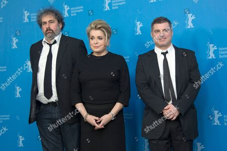 From left, actors Gustave Kervern and Catherine Deneuve with Director Pierre Salvadori pose for photographers at the photo call for the film In The Courtyard during the 64th Berlinale International Film Festival, in Berlin