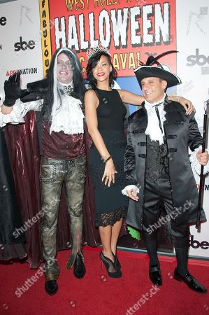 From left, David Cooley, Rihanna and guest attend Rihanna's naming as the queen of the West Hollywood Halloween Carnaval at Greystone Manor, in West Hollywood, Calif