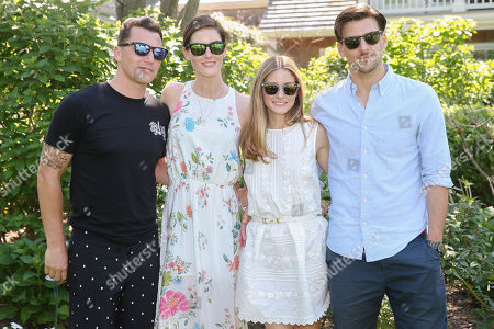 From left, former hockey player Sean Avery, model Hilary Rhoda, socialite Olivia Palermo, and model Johannes Huebl pose for a photograph at the Solid & Striped BBQ & Pool Party, in Southampton, N.Y