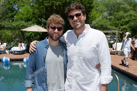 Solid & Striped founder Isaac Ross, right, poses for a photograph with a guest at the Solid & Striped BBQ & Pool Party, in Southampton, New York