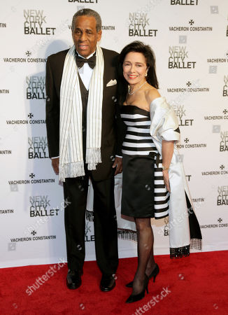 Stock Picture of Former Comptroller of New York State Carl McCall, left, and his wife, President of SUNY's Fashion Institute of Technology Joyce F. Brown, right, attend the New York City Ballet 2014 Spring Gala, in New York