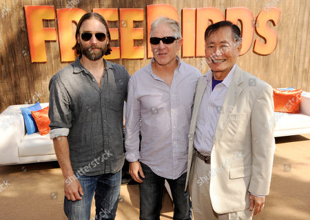 "Free Birds"" writer/producer Scott Mosier, left, poses with cast members Carlos Alazraqui, center, and George Takei at the after party for the premiere of the film at the Regency Village Theatre on in Los Angeles"
