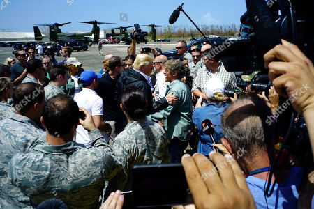President Donald Trump greets television personality Geraldo Rivera at the Luis Muñiz Air National Guard Base in San Juan, Puerto Rico, . Trump is visiting Puerto Rico in the wake of Hurricane Maria