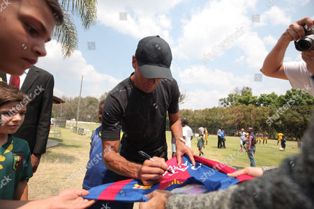 Former Brazilian and Barcelona soccer player Rivaldo (3L), signs a Barcelona FC shirt during a visit to the Legends Academy  at Hellenic Sports Club in Harare, Zimbabwe, 03 October 2017. Rivaldo is in Zimbabwe to promote a soccer match between former Barcelona players and Zimbabwe national team to be played in Zimbabwe in November 2017.