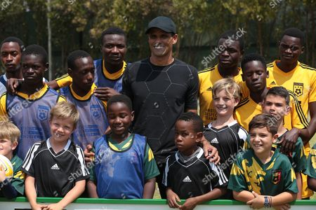 Former Brazilian and Barcelona soccer player Rivaldo (3L), poses for a picture with Legends Academy trainees at Hellenic Sports Club in Harare, Zimbabwe, 03 October 2017. Rivaldo is in Zimbabwe to promote a soccer match between former Barcelona players and Zimbabwe national team to be played in Zimbabwe in November 2017.