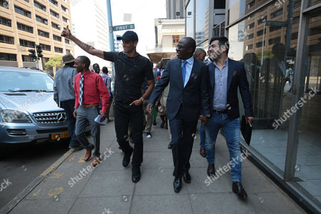 Former Brazilian and Barcelona soccer player Rivaldo (2L), flanked by Zimbabwean minister of Sport and Recreation Makhosini Hlongwane, (C) and fomer Barcelona trainee Rayco Garcia (right), as he visits Harare, Zimbabwe, 03 October 2017. Rivaldo is in Zimbabwe to promote a soccer match between former Barcelona players and Zimbabwe national team to be played in Zimbabwe in November 2017.