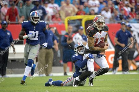 Landon Collins, Eli Apple, Mike Evans. Tampa Bay Buccaneers wide receiver Mike Evans (13) is tackled by New York Giants cornerback Eli Apple (24) after catching a pass as strong safety Landon Collins (21) watches during the first half of an NFL football game, in Tampa, Fla