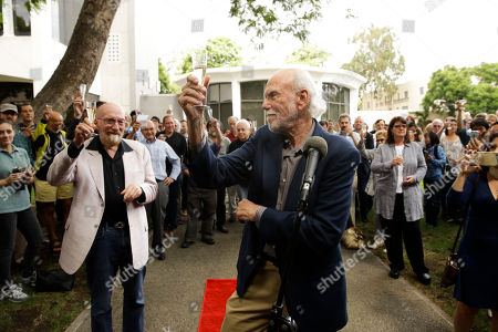 Barry Barish, Kip Thorne. Scientists Barry Barish, center, and Kip Thorne, both of the California Institute of Technology, share a toast to celebrate winning the Nobel Prize in Physics, in Pasadena, Calif. Barish and Thorne won the Nobel Physics Prize on Tuesday for detecting faint ripples flying through the universe, the gravitational waves predicted a century ago by Albert Einstein that provide a new understanding of the universe