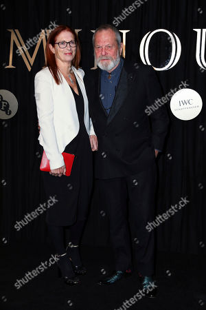 Maggie Weston, Terry Gilliam, Maggie Weston. Film Director Terry Gilliam, right, and his wife Maggie Weston, pose for photographers on arrival at the 'BFI Luminous' fundraising gala held by The British Film Institute, in London