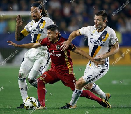 Stock Image of Jefferson Savarino, Jermaine Jones, Dave Romney. Real Salt Lake forward Jefferson Savarino, center, holds back Los Angeles Galaxy midfielder Jermaine Jones, left, and defender Dave Romney from the ball during the second half of an MLS soccer game in Carson, Calif