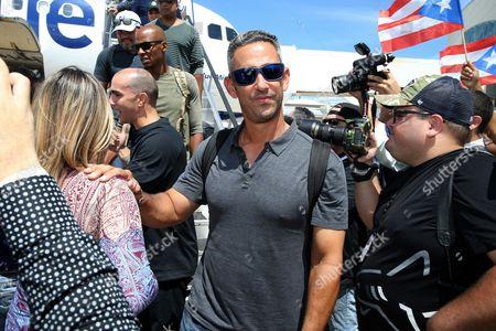 Former professional baseball player Jorge Posada arrive at Luis Munoz Marin International Airport in San Juan