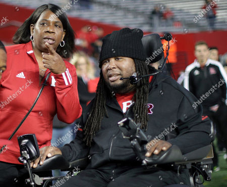 Eric LeGrand, Karen LeGrand. Eric LeGrand, a former Rutgers football player who sustained a spinal cord injury during a game in 2010, on the field with his mother, Karen LeGrand, before an NCAA college football game between Rutgers and Ohio State, in Piscataway, N.J