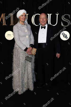 Julian Fellowes, Emma Kitchener Fellowes. Writer Lord Julian Fellowes and wife, Lady Emma Kitchener Fellowes, pose for photographers on arrival at the 'BFI Luminous' fundraising gala held by The British Film Institute, in London