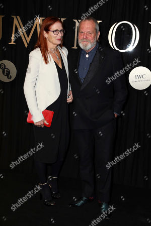 Maggie Weston, Terry Gilliam. Film Director Terry Gilliam, right, and his wife Maggie Weston, pose for photographers on arrival at the 'BFI Luminous' fundraising gala held by The British Film Institute, in London