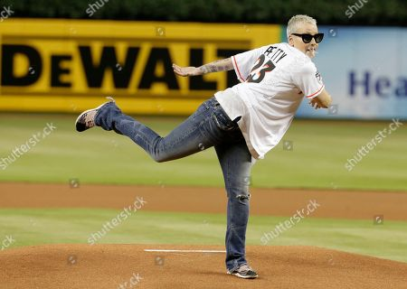 Stock Picture of Actress Lori Petty reacts after throwing a ceremonial pitch before a baseball game between the Miami Marlins and Chicago Cubs, in Miami. Petty was in the 1992 film A League of Their Own