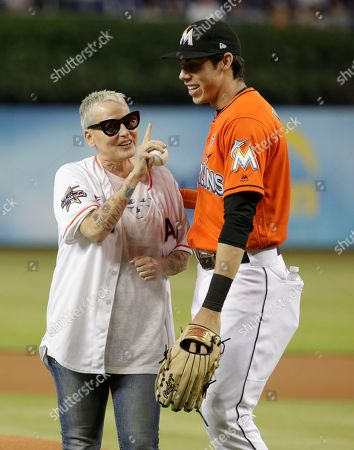 Lori Petty, Christian Yelich. Actress Lori Petty, left, poses with Miami Marlins center fielder Christian Yelich after throwing a ceremonial pitch before a baseball game between the Miami Marlins and Chicago Cubs, in Miami. Petty was in the 1992 film A League of Their Own