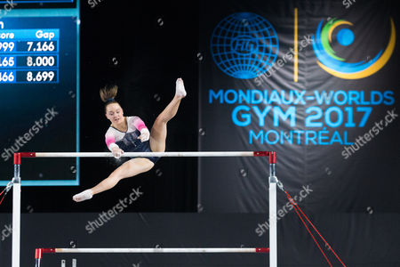 Amy Tinkler of Great Britain (557) performs her uneven bars routine during the Women's Qualifications of the World Artistic Gymnastics Championships at Olympic Stadium in Montreal, Canada