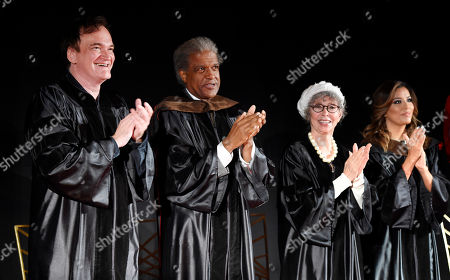 Honorees Quentin Tarantino, left, and Rita Moreno, second from right, applaud American Film Institute graduates along with speakers Elvis Mitchell, second from left, and Eva Longoria at the 2016 AFI Conservatory Commencement at the TCL Chinese Theatre, in Los Angeles